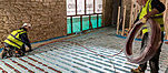 The contractor installed a 75mm thick pocketed polystyrene insulation layer alongside more than 1,000 linear metres of Wavin continuous 16mm diameter Polybutene pipe - finished with a 75mm thick screed.